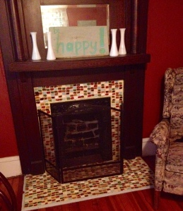 The fireplace looks like tile, but nope, I painted it.  The original plan was to tile it when funding allowed, but now we just love it.  All those squares were stamped on with make up sponges.